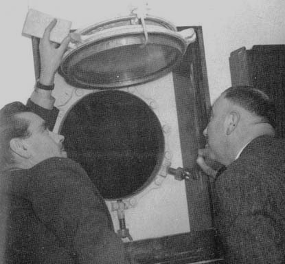 Detectives examine the porthole through which Gay Gibson's body was thrown.
