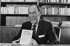 James A. Brussel with book Casebook of a Criminal Psychiatrist